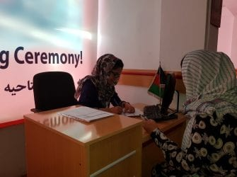 Two women doing business in Afghanistan bank
