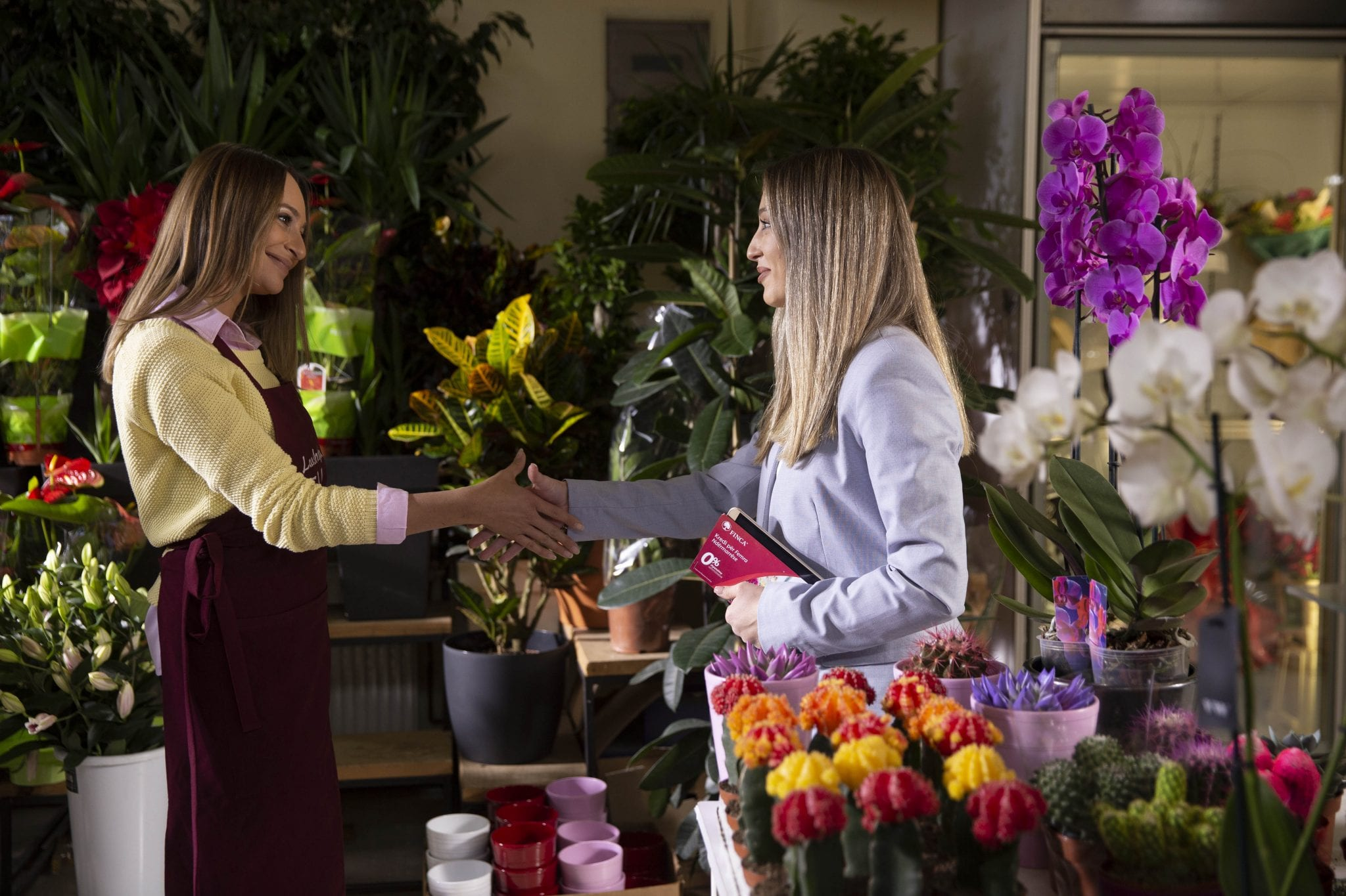 Female entrepreneurs in a flower shop promoting gender equality